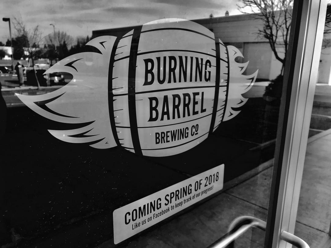 burning barrel logo on glass door